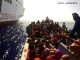 imigranti din Africa interceptati de Paza de Coasta din Italia
