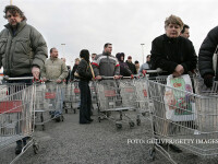 Shoppers wait to enter a Tesco hypermarket in Bratislava, Slovakia