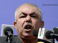 Afghan vice-presidential candidate Abdul Rahid Dostum, who is campaigning with presidential candidate Ashraf Ghani Ahmadzai, addresses the crowd during a gathering in the outskirts of Kunduz province, north of Kabul on March 19, 2014. Afghanistans April