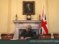 Theresa May semneaza scrisoarea de notificare privind Brexit