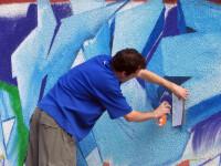 Graffiti legal pe gardul Politiei Capitalei