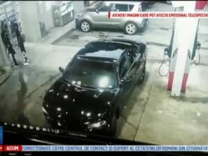 Schimburi de focuri intr-o benzinarie din Atlanta, intre doi barbati. Iubita unuia dintre ei, ranita de un glont