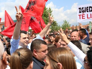 Leader of the Democratic Party of Albania Lulzim Basha (L) attends an unauthorized demonstration in Tirana, Albania
