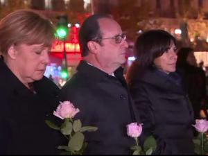 Francois Hollande si Angela Merkel