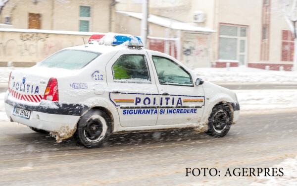 masina de politie iarna