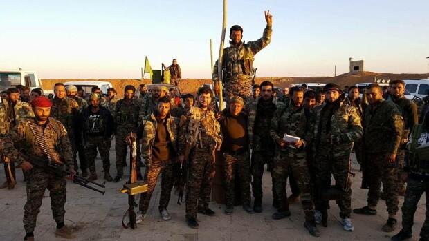 luptatori SDF inainte sa atace Rojava
