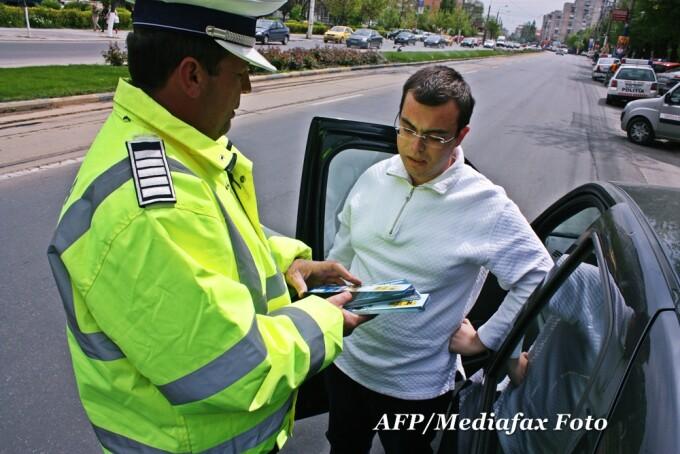 amenzi de circulatie, politia rutiera, politist