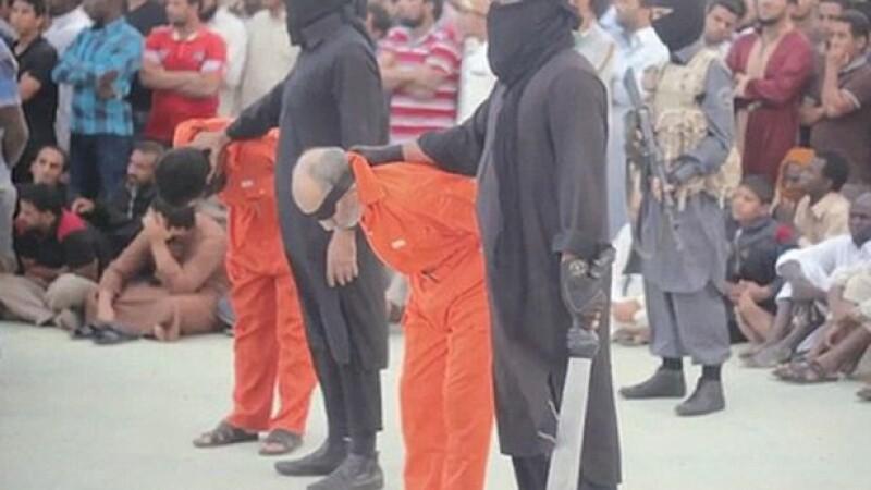 Jihadistii au publicat un nou video in care executa doi barbati acuzati de magie neagra. Imaginile va pot afecta emotional