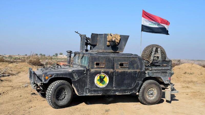 Cel putin 15 morti si 22 de raniti in atacul terorist asupra unei baze militare din Irak. Statul Islamic revendica atentatul