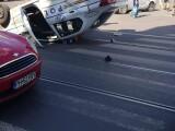 Accident petrecut în București: o mașină de poliție s-a răsturnat