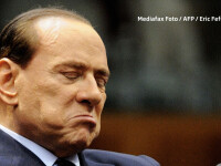 Berlusconi munceste in folosul comunitatii, printre oameni care probabil nici nu-l recunosc.