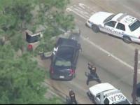 Momentul in care un suspect este impuscat mortal de politistii din Houston, difuzat in direct de un post de televiziune