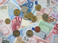 Moneda naţională creşte şi închide cursul la 3,5325 lei/euro