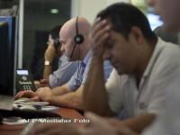 Agitatie pe Wall Street. Indicele Dow Jones incearca pragul de 3% in scadere