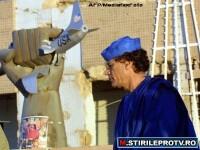 Aisha Ghaddafi: Tatal meu este bine, poarta arme si lupta pe front in Libia