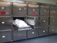 Inmormantare amanata dupa ce trupul neinsuflet a inghetat la morga sau cadavru cu doi creieri. Nereguli la morgile din UK