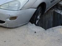 Un sofer din Craiova a ajuns cu masina intr-o groapa dintre blocuri, in miez de noapte. Cum se apara firma responsabila