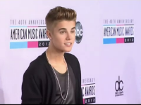 Justin Bieber vrea să se lupte cu Tom Cruise, în ring. Mesajul transmis