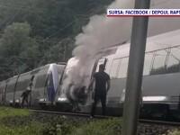 Clipe de panică pentru 200 de călători într-un tren privat, pe ruta București-Brașov. Locomotiva a luat foc