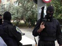 Sapte suspecti de licitatii ilegale pe internet, prinsi de politisti!