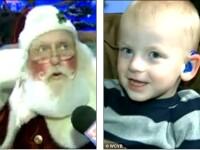 Un copil surd, prea speriat sa stea in poala lui Mos Craciun, are parte de o surpriza. VIDEO