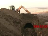 Doi hoti de fier vechi au murit ingropati sub un mal de pamant. Salvatorii i-au gasit dupa 13 ore