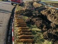 O bombă de aruncător și mai multe proiectile descoperite de o echipă de muncitori, în Timiș
