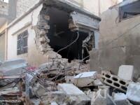 Cadavrele a cel putin 65 de persoane executate cu cate un glont in cap, descoperite in Siria