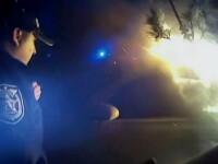 Doi politisti americani au fost decorati dupa ce au salvat un sofer dintr-o masina in flacari