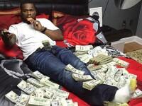 La cateva luni dupa ce si-a declarat falimentul, 50 Cent s-a pozat inconjurat de munti de dolari. Ce l-a anuntat un judecator