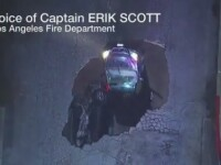 Momentul in care o masina se prabuseste intr-o gaura din asfaltul unei strazi din Los Angeles, surprins LIVE de o televiziune