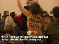 O militanta feminista cu bustul gol a peturbat discursul sustinut de Marine Le Pen, la Paris: \