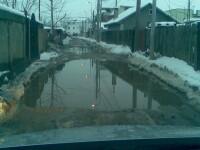 Bucuresti, oras european. Cu groapa si zapada pe drum neasfaltat