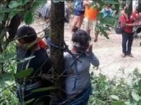 O femeie de 52 de ani a murit dupa ce a fost legata de un copac plin cu furnici veninoase. Ce acuzatii i s-au adus victimei