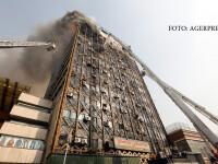Un centru comercial cu 17 etaje s-a prabusit in centrul Teheranului. Cel putin 20 de pompieri sositi la interventie au murit