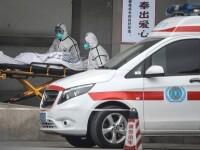 Chinezii stau ore în șir la coadă pentru a ridica cenușa rudelor moarte de Covid-19