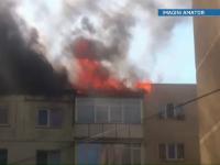 Incendiu pe acoperisul unui bloc din Curtea de Arges. Zece persoane au avut nevoie de ingrijiri