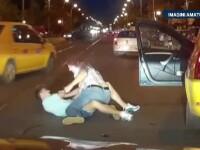 Bataie intre un tanar si un sofer de taxi, in Bucuresti. Cei doi s-au certat intial pe o trecere de pietoni. VIDEO