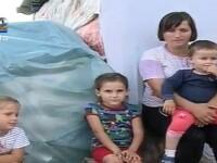 Viata traita la limita extrema. O familie cu 3 copii locuieste in caroseria unei masini. VIDEO