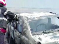Incident bizar pe un camp in Arges. Un sofer a ambalat atat de tare motorul incat a dat foc la miriste si la masina