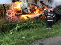Impact între un camion cu grâu şi un autoturism, pe DN 2A. Un șofer a murit, iar TIR-ul a luat foc
