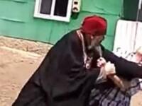 Momentul în care un preot beat a bătut un bărbat la o înmormântare. Ce l-a înfuriat