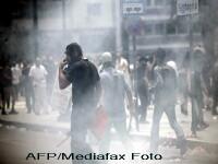 Atena fierbe: manifestantii s-au luptat cu politia, la un miting