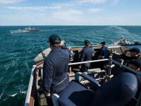 Marina americana a prezentat imagini cu momentul in care nava USS Ross se intalneste cu un avion de atac rusesc. VIDEO