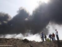 Dezastru ecologic in Ucraina. Incendiul de la depozitul petrolier provoaca aparitia ploilor acide: