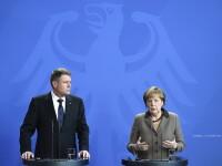Iohannis, primit la Berlin cu prietenie de Merkel: