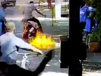Momentul șocant în care un motociclist ia foc accidental, după ce este stropit cu dezinfectant. VIDEO