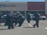 VIDEO. Un polițișt, acuzat că a pus genunchiul pe gâtul unei femei în timp ce o aresta