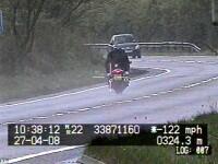 A mers cu motocicleta cu 200 km/h, cu fiul de 14 ani in spate!