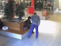 Imagini SOCANTE, chiar si pentru politisti. Femeie batuta cu salbaticie intr-un mall. VIDEO